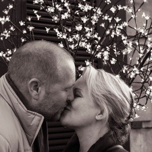 Romantic Paris couple portrait kissing