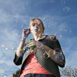 Girl blowing bubbles by David Woolfall London photographer