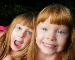 Red haired blue eyed sisters by Glasgow photographers Chris Logue and Ewan Cameron
