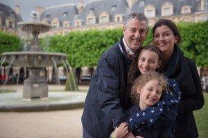 Family portrait in Paris Places des Vosges - by vacation photographer in Paris, TripShooter