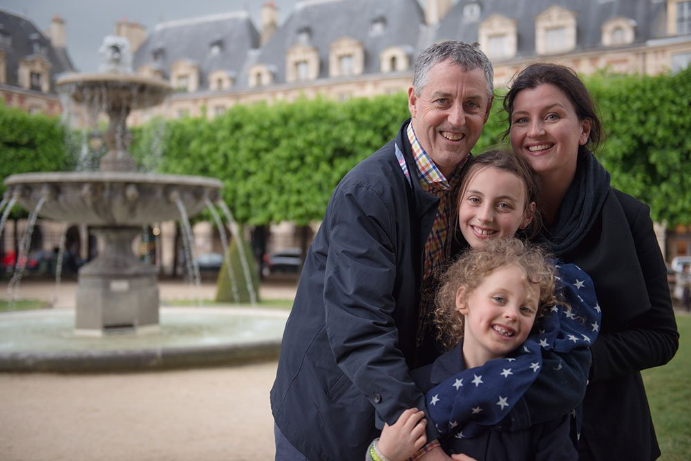Family portrait in Paris Places des Vosges - by vacation photographer in Paris, TripShooter