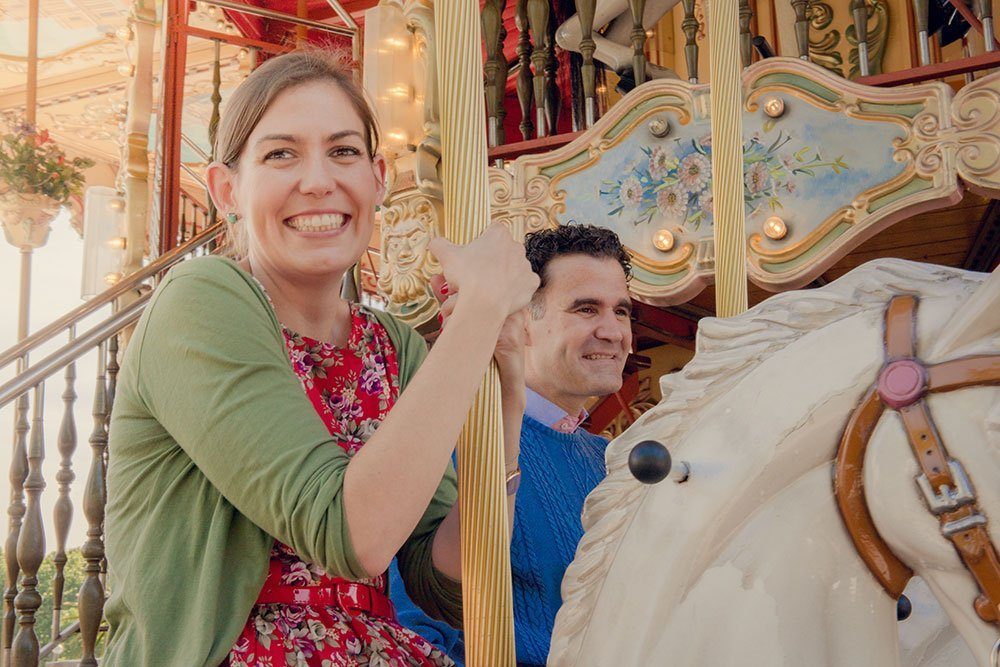 Cute couple on carousel in Paris