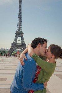 Honeymoon couple kissing at Eiffel Tower Paris