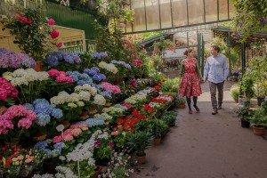 Loving honeymoon couple walking at Paris flower market