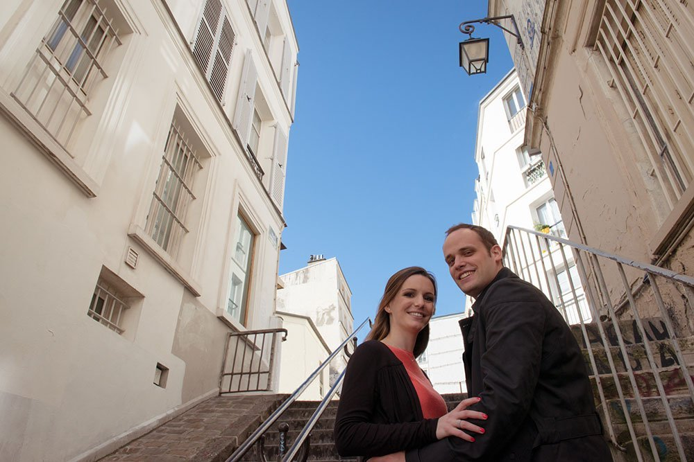 Happy couple on Montmartre steps by Paris photographer Jade Maitre for TripShooter
