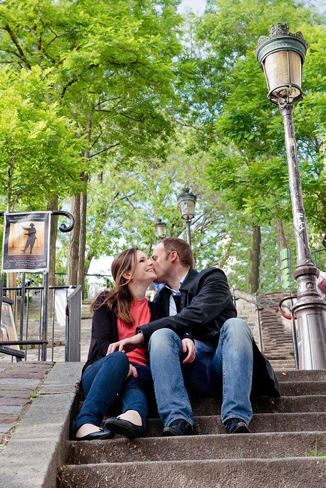 Romantic couple portrait kissing on Montmartre steps by Paris photographer Jade Maitre for TripShooter