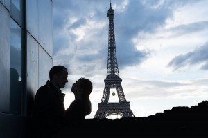 Silhouette of romantic couple and Eiffel Tower by Paris photographer Jade Maitre