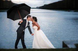 Playful portrait of wedding couple with umbrella by Pierre Turyan, TripShooter Paris Photographer