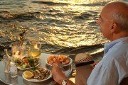 Delicious Greek meal by the water at sunset