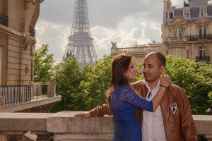 A happy honeymoon couple embrace in Paris on a romantic photo shoot. Photos by Paris photographer Jade Maitre.