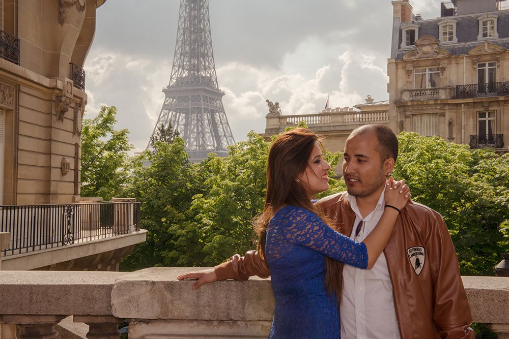A happy honeymoon couple embrace in Paris on a romantic photo shoot