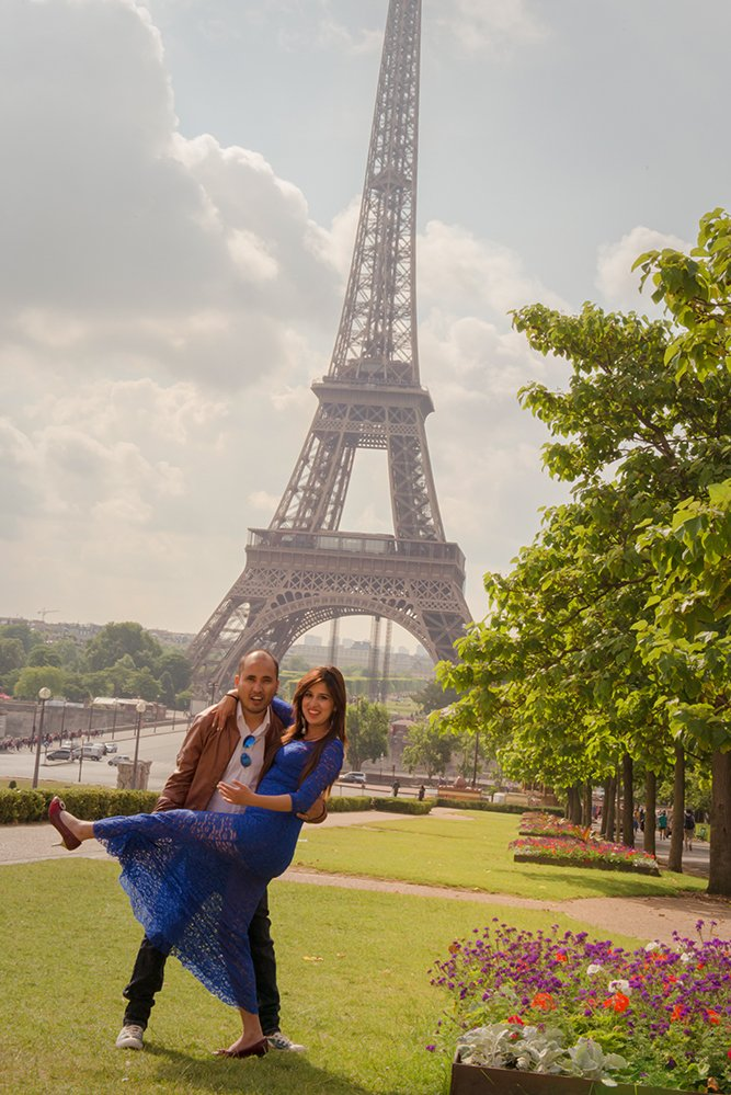 A happy honeymoon couple with the Eiffel Tower on a romantic photo shoot in Paris France