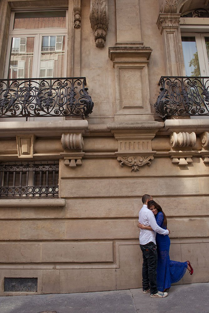A loving honeymoon couple embrace on a romantic photo shoot in Paris France.