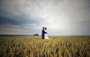 Married couple in a field by Ewa Wijita TripShooter Edinburgh Photographer