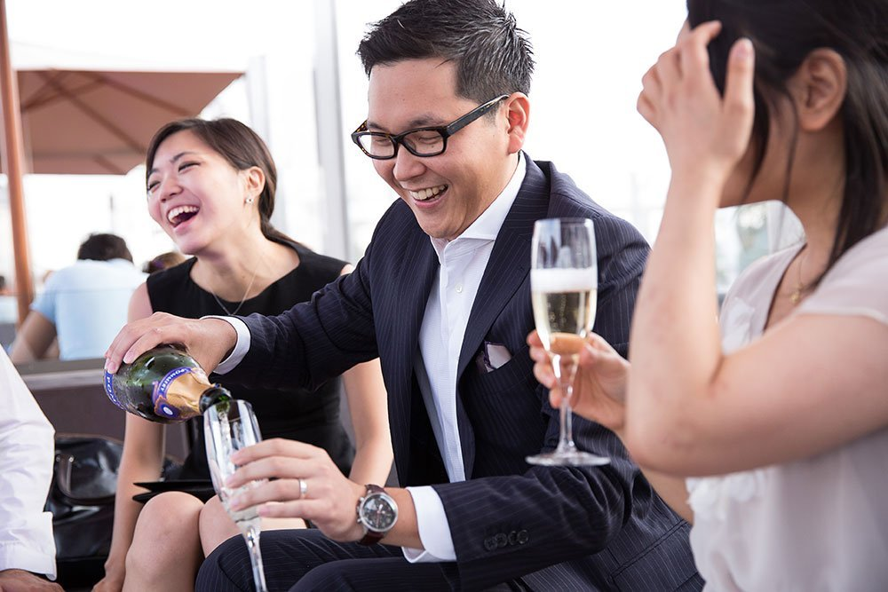 Couple enjoy champagne at proposal portrait session by Madrid Photographer Ludovic Magnoux for TripShooter