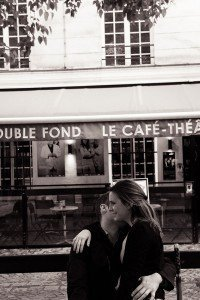 Loving couple portrait and French cafe by Paris photographer Jade Maitre for TripShooter
