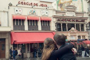 Loving anniversary photo of couple at Clignancourt Paris by Paris photographer Jade Maitre