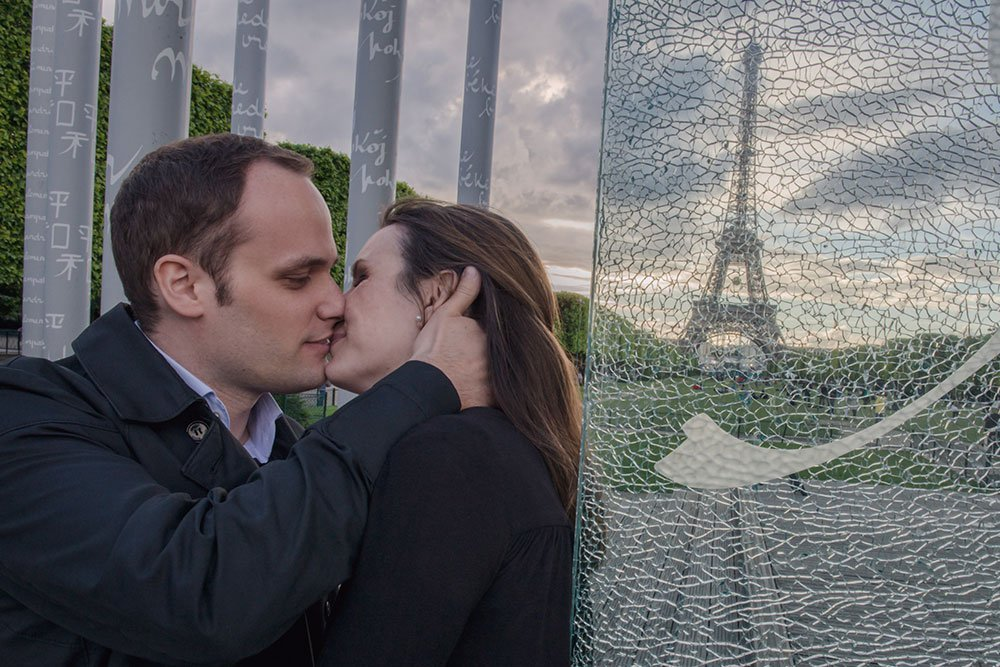 Romantic Couple Kissing By Eiffel Tower by Paris photographer Jade Maitre
