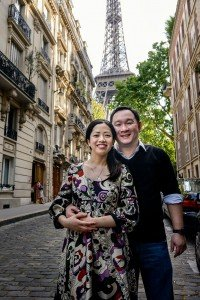 Happy couple portrait at Eiffel Tower by Paris photographer Pierre Turyan for TripShooter