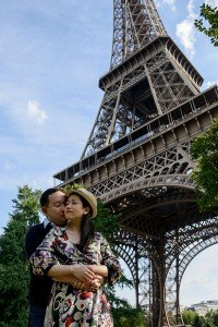 Loving couple kissing in front of Eiffel Tower, by Paris photographer Pierre Turyan for TripShooter