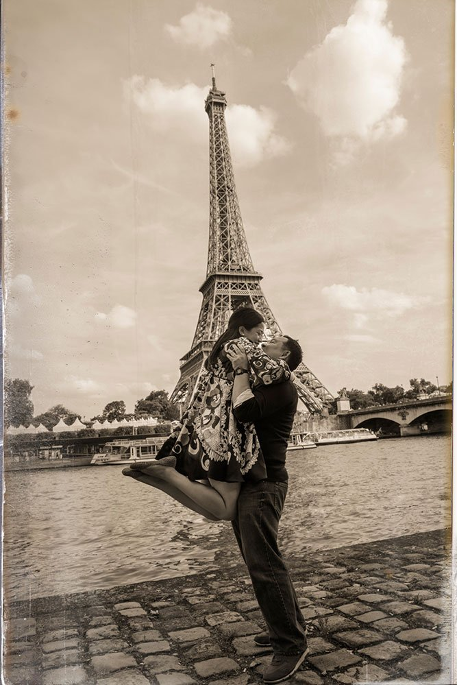 Couple embracing in the air in front of Eiffel Tower, by Paris photographer Pierre Turyan for TripShooter