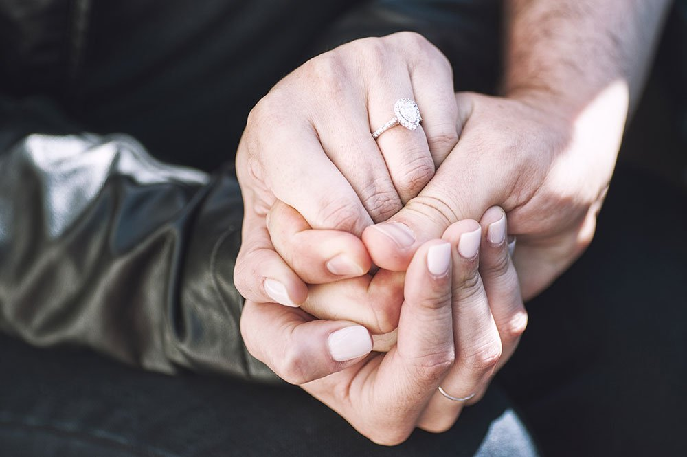 Engagement ring and loving hands by TripShooter Amsterdam photographer Sal Marston