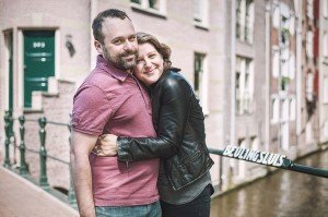 Couple in love at canal in portrait by TripShooter Amsterdam photographer Sal Marston