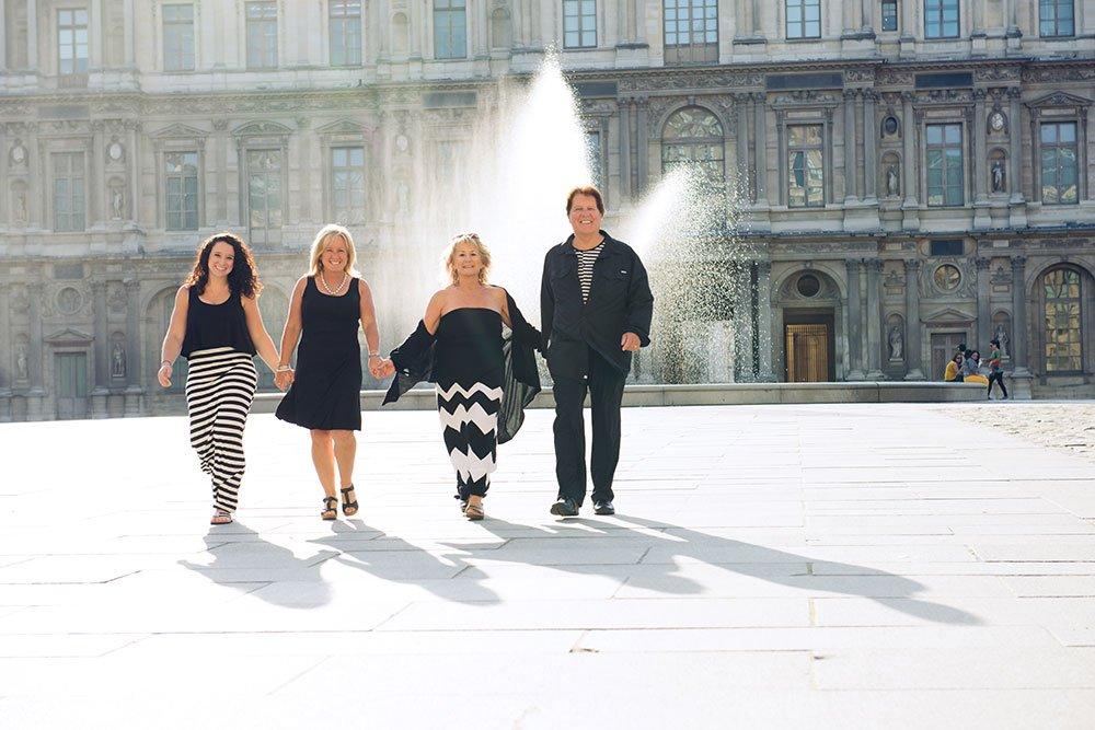 Unique colour family portrait of three generations at Louvre Place Carre by Paris photographer Jade Maitre