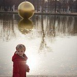 Photo of boy by lake at Tuileries by Paris photographer Jade Maitre