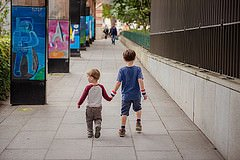 Photo of brothers holding hands at Dupleix by Paris photographer Jade Maitre