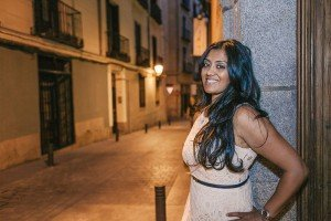 Smiling woman with street lights in Madrid, byTripShooter Madrid photographer Laura Emme