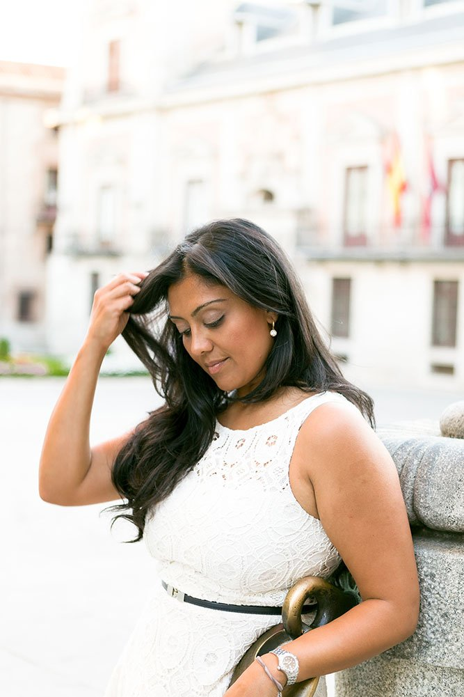 Woman touches hair on Spanish vacation by TripShooter photographer in Madrid Laura Emme