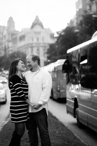Honeymoon couple smile on busy Madrid street, by TripShooter Madrid Photographer Ludovic Magnoux