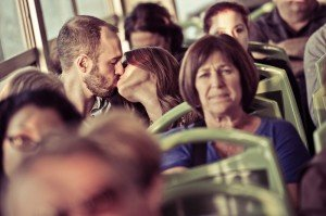 Couple kiss on Venetian ferry boat by TripShooter Venice photographer Selene Pozzer