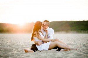 Romantic couple portrait on the beach at sunset, by TripShooter photographers in Warsaw, Diana and Rafal Krasa