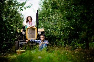 Cute Polish loveshoot on farm tractor, by TripShooter photographers in Warsaw, Diana and Rafal Krasa