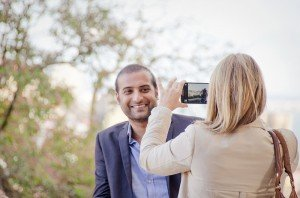 Couple take photographs with mobile phone before surprise marriage proposal in Lisbon, photo by TripShooter's photographer in Lisbon, Ricardo Junqueira