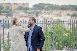 Newly engaged couple at MiradourodeSãoPedrodeAlcantara in Lisbon, photo by TripShooter's Lisbon photographer Ricardo Junqueira