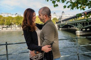 Loving couple embrace by the Seine by TripShooter's Paris photographer Pierre Turyan