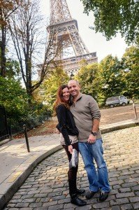 Happy loving couple pose for photos at Eiffel Tower, by TripShooter's Paris photographer Pierre Turyan