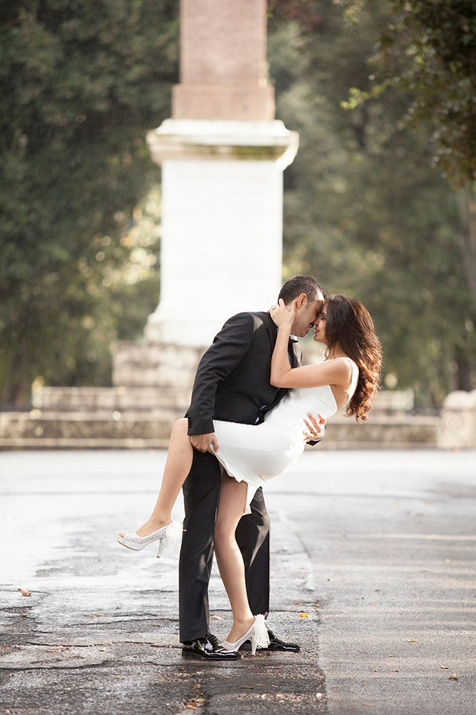 Wedding in Rome; couple embrace in a park. Photos by TripShooter Rome photographer Alex Marchese