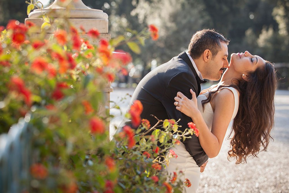 Rome romance as husband kisses newlywed wife at destination wedding, photos by TripShooter Rome photographer Alex Marchese