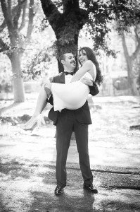 Beautiful couple portrait of husband lifting his wife in a park, photos by TripShooter Rome photographer Alex Marchese