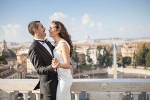 Couple laughing and dancing while Rome sightseeing, photos by TripShooter Rome photographer Alex Marchese