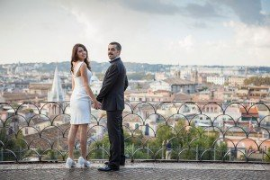 Destination wedding couple hold hands at Roman lookout, photos by TripShooter Rome photographer Alex Marchese