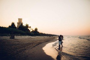 Romantic vacation couple portrait at beach at sunset, by TripShooter's photographer in Italy Giancarlo Malandra