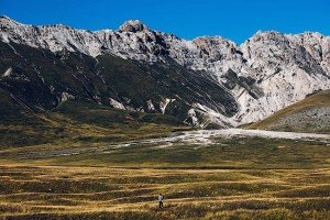 Stunning vacation photo of hiker in Italian mountains, by TripShooter's photographer in Italy Giancarlo Malandra