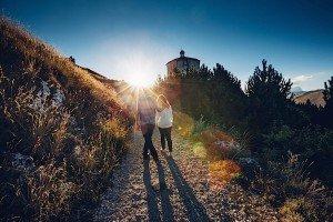 Honeymoon couple portrait walking into Italian sun, by TripShooter's photographer in Italy Giancarlo Malandra