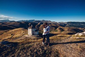 Loving couple hug on mountain by TripShooter photographer in Italy Giancarlo Malandra