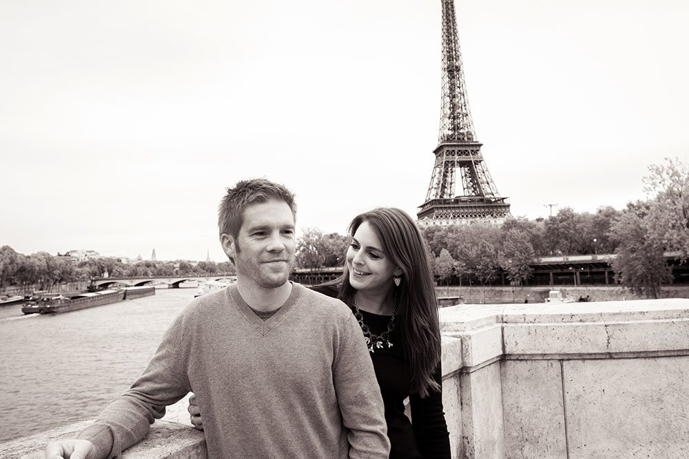 Black and white couple portrait at Eiffel Tower. Photo Loving couple stroll in Paris. Portrait by TripShooter Paris photographer Jade Maitre